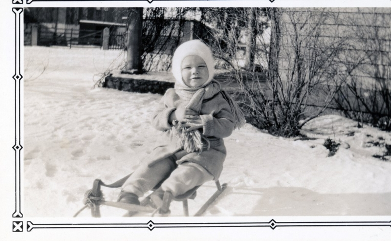 DAD-on sled in snow
